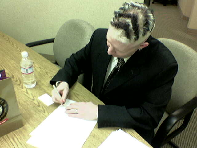 Our fearless leader signs the CC26 Contract